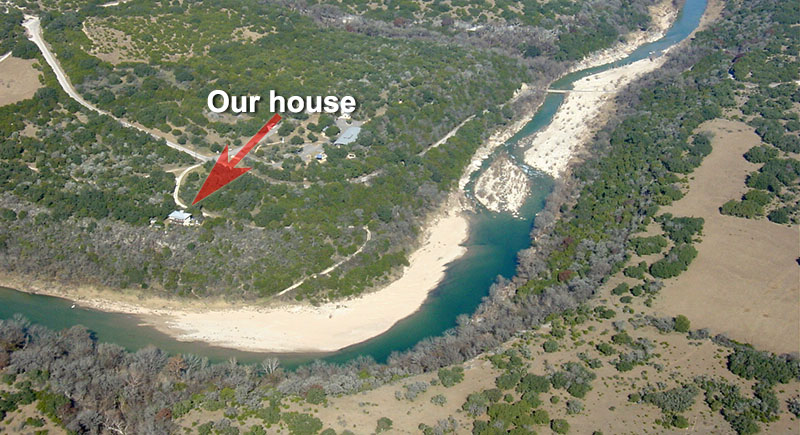 Aerial of House and River by Andrew McCalla