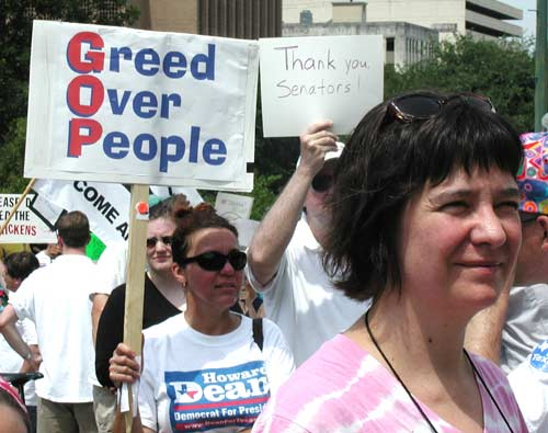 GOP = Greed Over People sign.